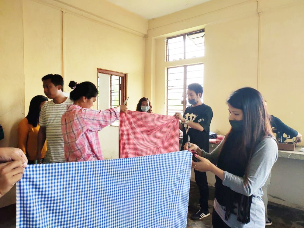 Some of the teachers preparing curtains for the quarantine centre at ITI Mon.
