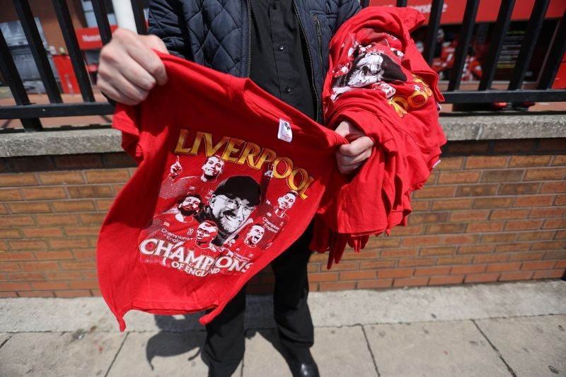 """Liverpool Champions of England"" t-shirts are seen for sale after Liverpool were crowned Premier League champions last night after Chelsea won their match against Manchester City Action Images via Reuters/Carl Recine"