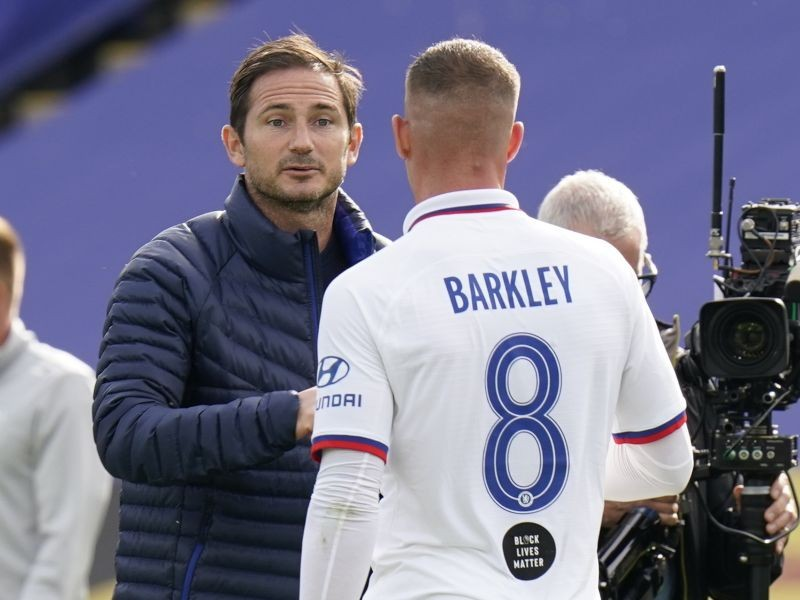 Chelsea manager Frank Lampard with Ross Barkley after the match, as play resumes behind closed doors following the outbreak of the coronavirus disease (COVID-19) Tim Keeton/Pool via REUTERS