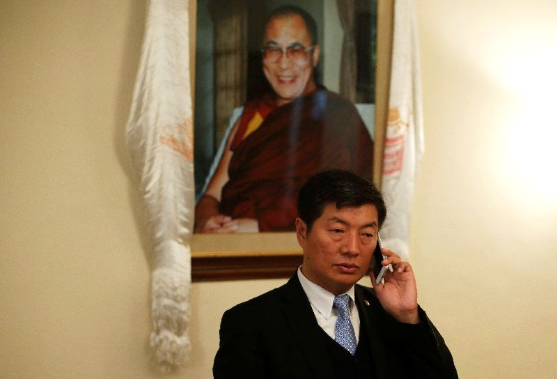 Lobsang Sangay, Prime Minister of the Tibetan government-in-exile, speaks on his mobile phone before an interview with Reuters in New Delhi, India, December 16, 2016. To match Interview INDIA-TIBET/ REUTERS/Adnan Abidi