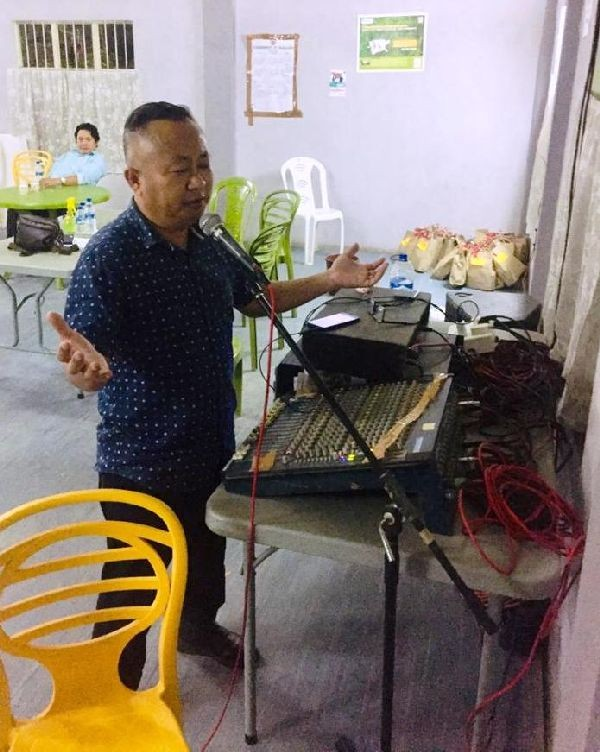 Associate Pastor of Dimapur Ao Baptist Arogo, Toshi Longkumer conducts a fellowship through PA system at a quarantine centre in Dimapur without coming into direct contact with the occupants.