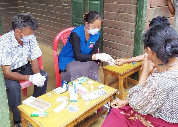 Health workers screening people during house visits in Phek.