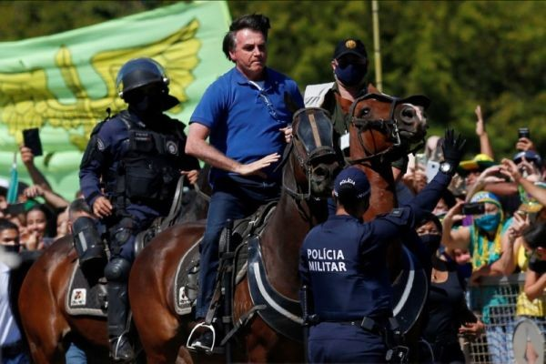 Brazil's President Jair Bolsonaro rides a horse during a meeting with supporters protesting in his favor, amid the coronavirus disease (COVID-19) outbreak, in Brasilia, Brazil on May 31, 2020. (REUTERS File Photo)