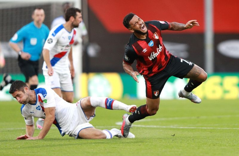 Bournemouth's Joshua King sustains an injury after a challenge by Crystal Palace's Gary Cahill as play resumes behind closed doors following the outbreak of the coronavirus disease (COVID-19) Ian Walton/Pool via REUTERS/File Photo