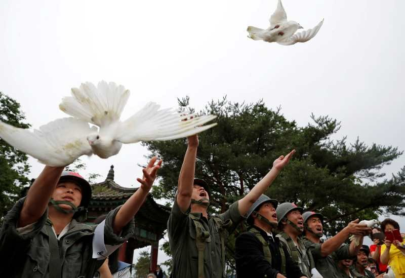 Doves are released during a ceremony commemorating the 70th anniversary of the Korean War, near the demilitarized zone separating the two Koreas, in Cheorwon, South Korea on June 25. (Reuters Photo)