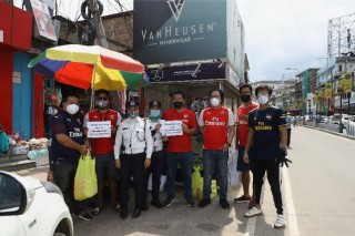 Members of the Arsenal Supporters Club Nagaland handing out refreshments to frontline workers in Dimapur on June 1.