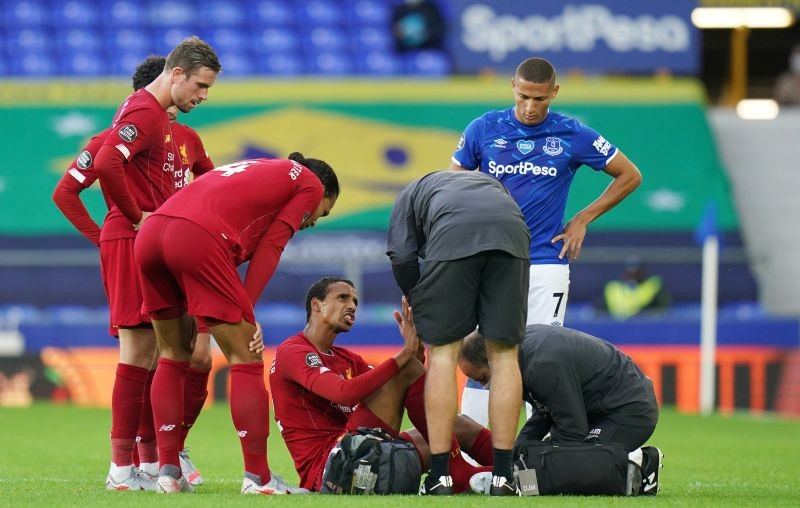 Liverpool's Joel Matip receives medical attention, as play resumes behind closed doors following the outbreak of the coronavirus disease (COVID-19) Jon Super/Pool via REUTERS/File Photo