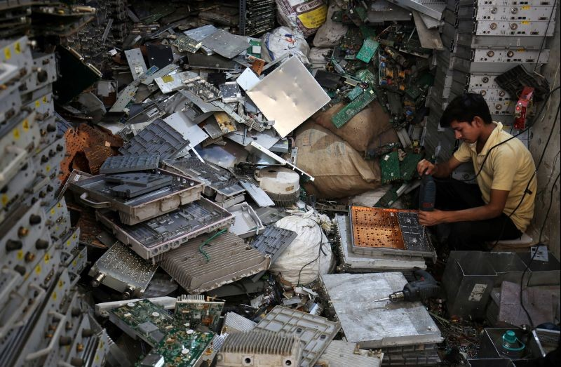 A worker dismantles electronic waste at a workshop in New Delhi on June 5, 2018. (REUTERS File Photo)