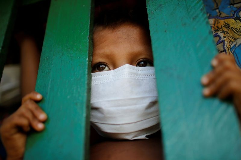 A child from the indigenous Yanomami ethnic group wearing protective face mask looks on, amid the spread of the coronavirus disease (COVID-19), at the 5th Special Frontier Platoon in the municipality of Auaris, state of Roraima, Brazil on June 30, 2020. (REUTERS File Photo)