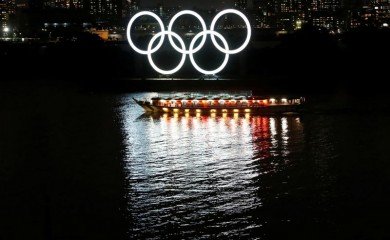 "FILE PHOTO: A Japanese-style tour boat called ""Yakatabune"" sails in front of giant Olympic rings at the waterfront area as the spread of the coronavirus disease (COVID-19) continues, at Odaiba Marine Park in Tokyo, Japan, June 2, 2020. REUTERS/Issei Kato/File photo"