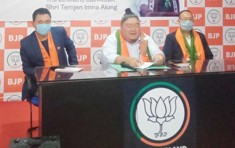 Nagaland state BJP president Temjen Imna Along (c) addressing the press conference in Kohima on July 2. (Morung Photo)