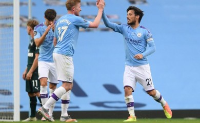 Manchester City's David Silva celebrates scoring their fourth goal with Kevin De Bruyne, as play resumes behind closed doors following the outbreak of the coronavirus disease (COVID-19) Michael Regan/Pool via REUTERS