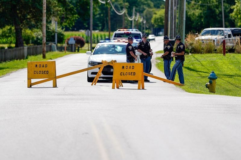 Indiana State Troopers block a road leading to the Federal Correctional Institution, Terre Haute, as officials await word about the stay of execution issued for Daniel Lewis Lee, who is convicted in the killing of three members of an Arkansas family in 1996, and would be the first federal execution in 17 years at the United States Penitentiary in Terre Haute, Indiana, US on July 13, 2020.  (REUTERS  Photo)