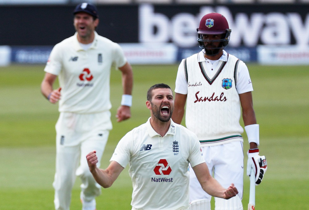 England's Mark Wood celebrates taking the wicket of West Indies' Shai Hope, as play resumes behind closed doors following the outbreak of the coronavirus disease (COVID-19) Adrian Dennis/Pool via REUTERS