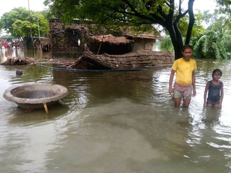 The flood havoc in Bihar is continuously worsening as people in 12 districts are bearing the brunt of floods due to overflow in almost all major rivers and tributaries in the state. (IANS Photo)
