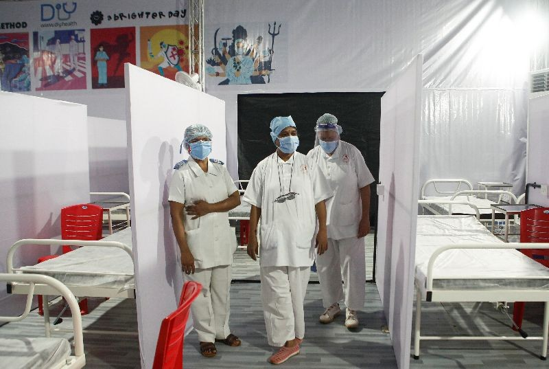 Nurses wearing protective masks stand inside a temporary facility created to facilitate cancer patients diagnosed with coronavirus disease (COVID-19) in Mumbai, India, July 30, 2020. REUTERS/Francis Mascarenhas