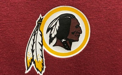 FILE PHOTO: A Washington Redskins football team logo is seen on a shirt at a sporting goods store in Bailey's Crossroads, Virginia, U.S., June 24, 2020. REUTERS/Kevin Lamarque/File Photo