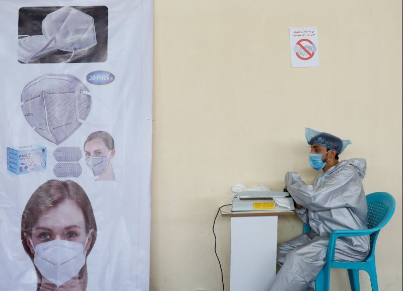 A man wears a protective face mask as he works at a mask factory, during the coronavirus disease (COVID-19) outbreak in Kabul, Afghanistan on July 2, 2020. (REUTERS File Photo)