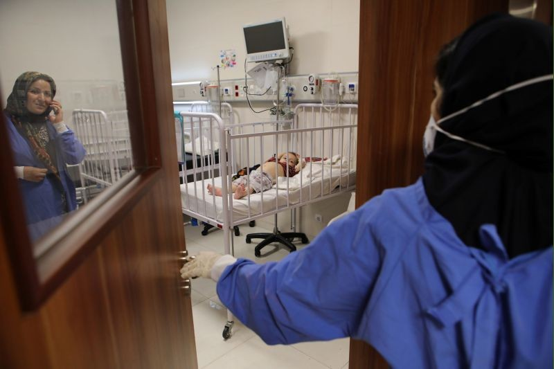 A child lies on a bed at Mofid children's hospital, where children suspected to be infected with the coronavirus disease (COVID-19) are treated, in Tehran, Iran on July 8, 2020 .(REUTERS File Photo)