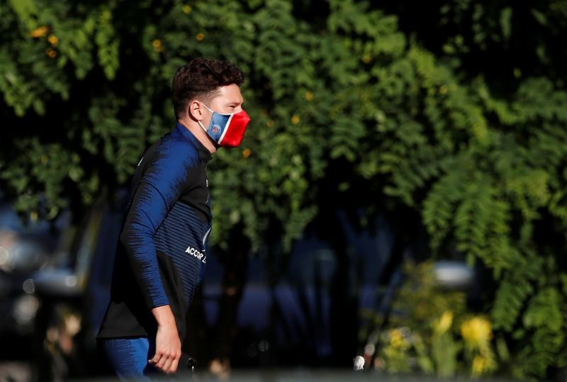 Paris St Germain's Julian Draxler is seen wearing a protective face mask as he arrives for training following the outbreak of the coronavirus disease (COVID-19) REUTERS/Benoit Tessier