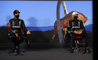 Mercedes' Valtteri Bottas and Lewis Hamilton wearing protective face masks during the press conference after qualifying, as F1 resumes following the outbreak of the coronavirus disease (COVID-19) Mario Renzi/Pool via REUTERS
