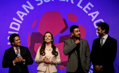 FILE PHOTO: Bollywood actors and co-owners of football clubs, Abhishek Bachhan (R) and Ranbir Kapoor (2nd R), and Nita Ambani, businesswoman and promoter of the Indian Super League, react as retired cricketer and co-owner of the Kerala Blasters Sachin Tendulkar (L) speaks during the emblem-unveiling ceremony of Indian Super League in Mumbai August 28, 2014. REUTERS/Danish Siddiqui/File Photo