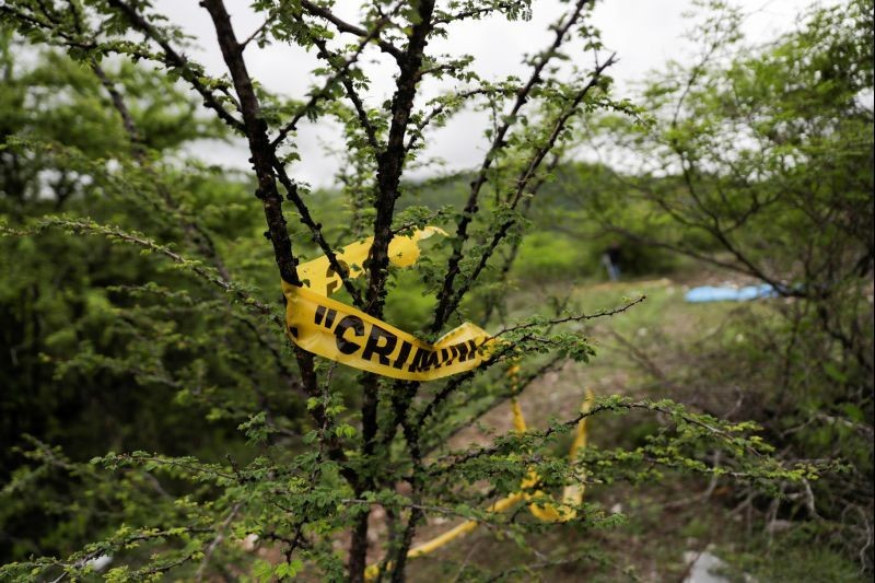 Yellow police tape is seen at the Barranca del Carnicero (Butcher's Ravine) where the remains of Christian Alfonso Rodriguez Telumbre, one of the 43 missing students from Ayotzinapa Rural Teachers' College, were found, at the mountain town of Cocula, near Iguala in the southwestern state of Guerrero, Mexico on July 8, 2020. (REUTERS File Photo)