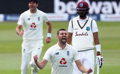 England's Mark Wood celebrates taking the wicket of West Indies' Shai Hope, as play resumes behind closed doors following the outbreak of the coronavirus disease (COVID-19) Adrian Dennis/Pool via REUTERS