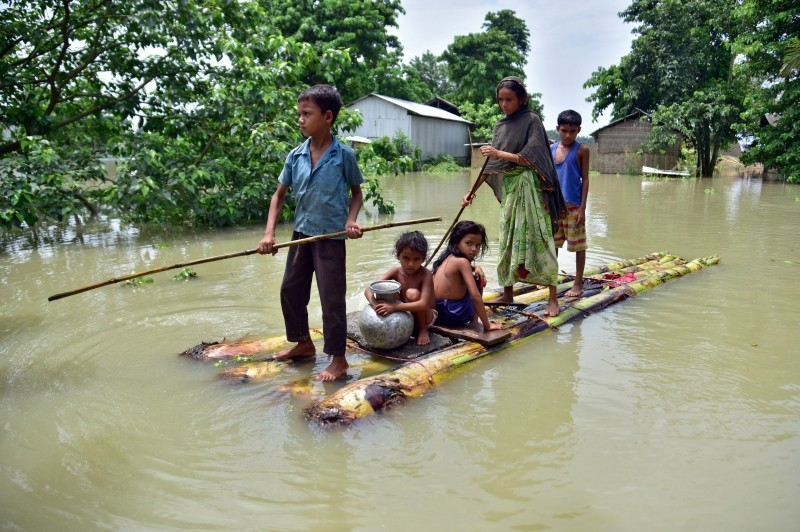 Villagers row a makeshift raft through a flooded field to reach a safer place at the flood-affected Mayong village in Morigaon district, in the northeastern state of Assam. (Reuters File Photo)
