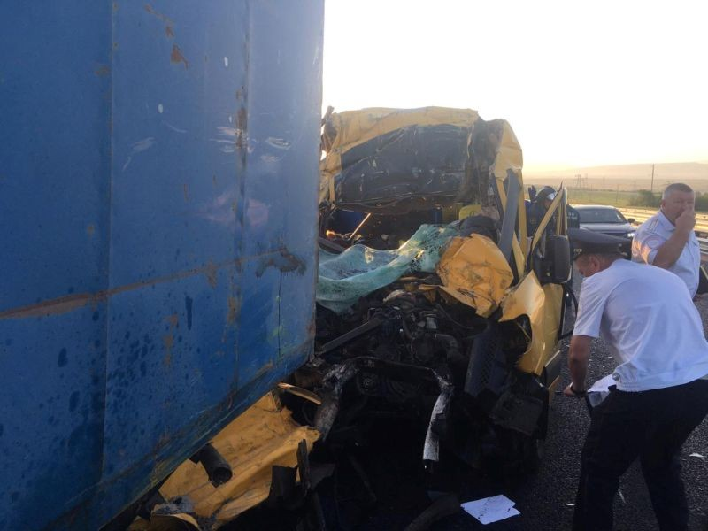 Members of Russian Emergencies Ministry and police officers inspect a minibus that crashed into a truck near the town of Belogorsk, Crimea on July 31, 2020. (REUTERS Photo)