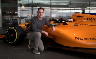 Nascar driver Jimmie Johnson poses for a photograph with an F1 car at the McLaren Technology Centre in Woking, Britain November 21, 2018. REUTERS/Will Russell/Files