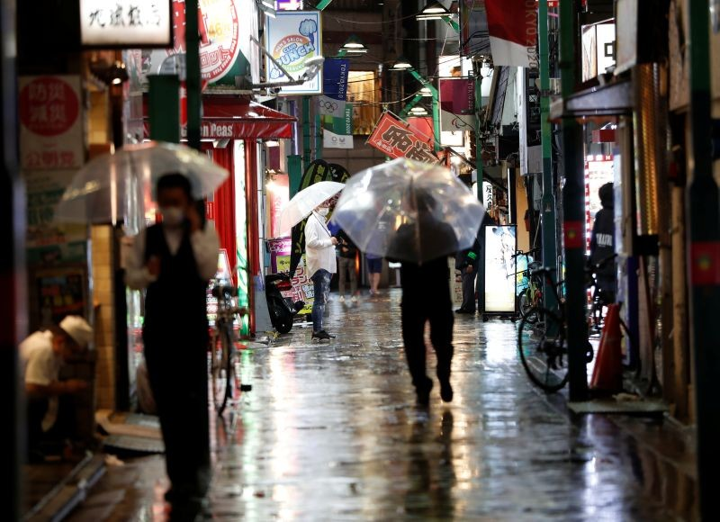 Passersby wearing protective face masks walk on the street amid the coronavirus disease (COVID-19) outbreak, at Ikebukuro's amusement district in Tokyo, Japan on July 9, 2020.  (REUTERS File Photo)