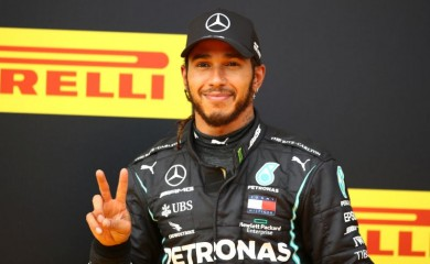 Mercedes' Lewis Hamilton celebrates winning the race, following the resumption of F1 after the outbreak of the coronavirus disease (COVID-19) Mark Thompson/Pool via REUTERS