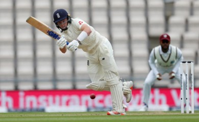 England's Ollie Pope hits a four, as play resumes behind closed doors following the outbreak of the coronavirus disease (COVID-19) Adrian Dennis/Pool via REUTERS