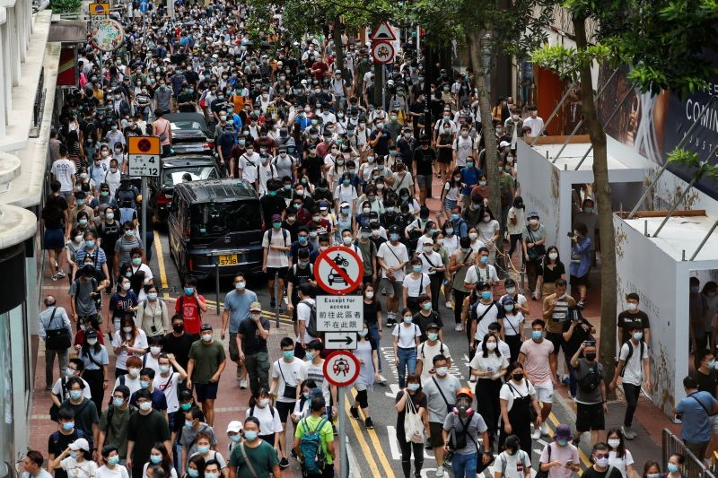 Anti-national security law protesters march at the anniversary of Hong Kong's handover to China from Britain, in Hong Kong, China on July 1, 2020. (REUTERS Photo)