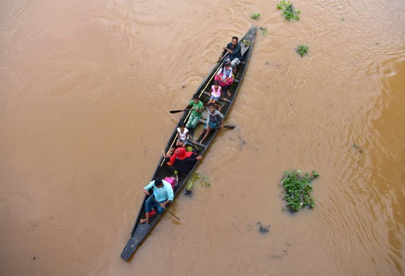 Flood-affected villagers are transported by boat to safety at Kachua village in Nagaon district, in the northeastern state of Assam on July 22, 2020. (REUTERS File Photo)