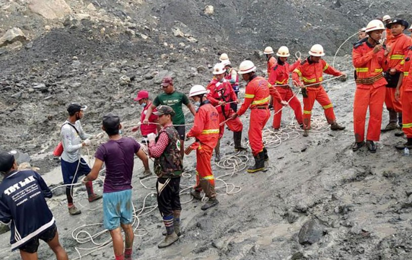 A handout photo made available by the Myanmar Fire Services Department shows rescue workers at a jade mining site in Hpakant, Myanmar, on July 2.