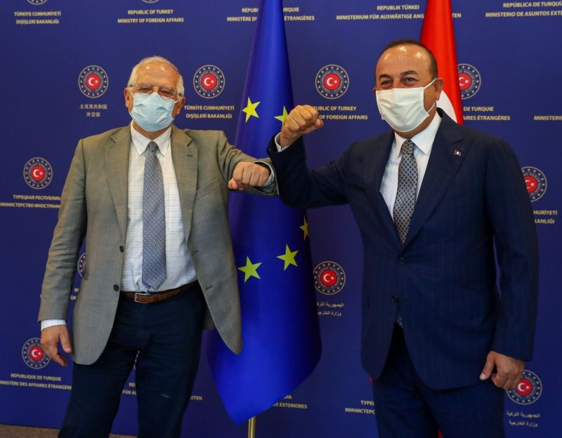 Turkish Foreign Minister Mevlut Cavusoglu and Josep Borrell Fontelles, High Representative of the European Union for Foreign Affairs and Security Policy, both wearing protective face masks, pose before their meeting in Ankara, Turkey on July 6, 2020. (REUTERS Photo)