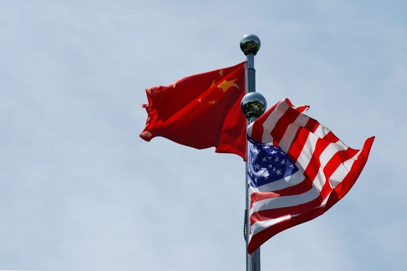 Chinese and U.S. flags flutter before a trade meeting in Shanghai, China on July 30, 2019.  (REUTERS File Photo)