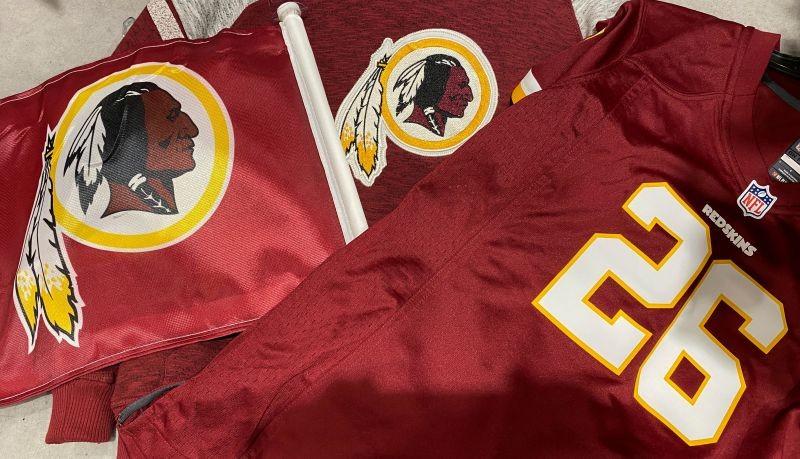 FILE PHOTO: Washington Redskins football shirts and a team flag on sale at a sporting goods store in Bailey's Crossroads, Virginia, U.S., June 24, 2020. REUTERS/Kevin Lamarque/File Photo