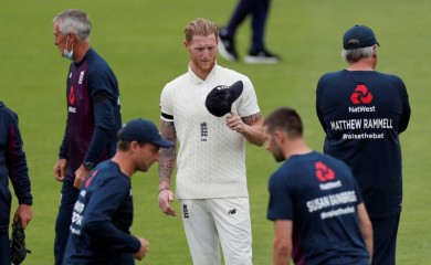England's Ben Stokes with teammates before the start of play, as play resumes behind closed doors following the outbreak of the coronavirus disease (COVID-19) Adrian Dennis/Pool via REUTERS