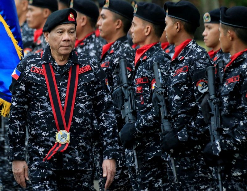 Philippine President Rodrigo Duterte, wearing a military uniform, reviews scout ranger troops upon his arrival during the 67th founding anniversary of the First Scout Ranger regiment in San Miguel town, Bulacan province, north of Manila, Philippines on November 24, 2017. (REUTERS File Photo)