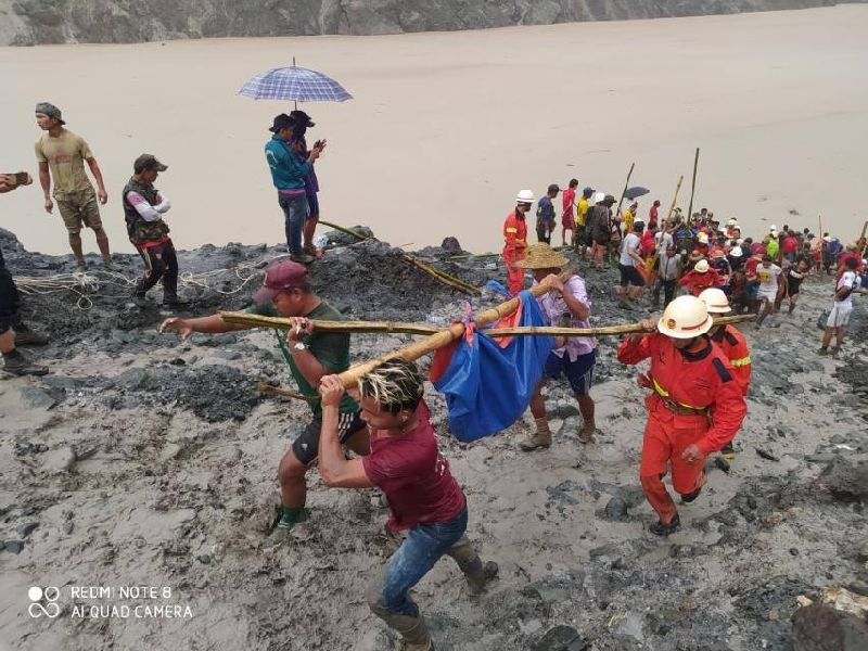 SENSITIVE MATERIAL. THIS IMAGE MAY OFFEND OR DISTURB People carry a dead body following a landslide at a mining site in Phakant, Kachin State City, Myanmar July 2, 2020, in this picture obtained from social media. MYANMAR FIRE SERVICES DEPARTMENT/via REUTERS