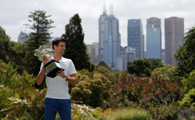 Australian Open champion Serbia's Novak Djokovic poses with the trophy during a photo shoot at the Royal Botanic Gardens Victoria. REUTERS/Issei Kato/File Photo