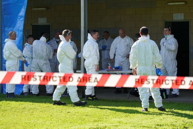 Fire Services Victoria personnel wearing hazmat suits meet in a restricted area outside a public housing tower, locked down in response to an outbreak of the coronavirus disease (COVID-19), in Melbourne, Australia on July 8. (REUTERS Photo)