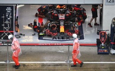 Red Bull engineers with Alexander Albon's car in the garage as rain delays qualifying, following the resumption of F1 after the outbreak of the coronavirus disease (COVID-19) on July 11, 2020. Joe Klamar/Pool via REUTERS