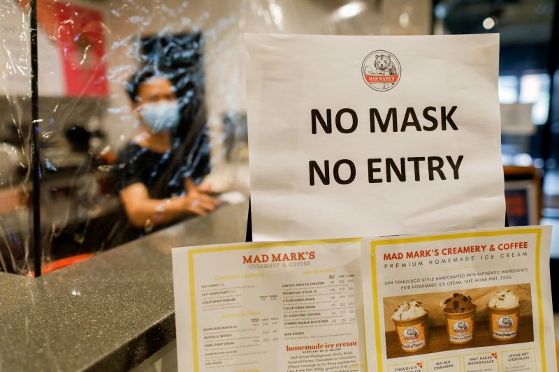 "A ""no mask, no entry"" reminder for take-away customers and delivery riders is posted outside a restaurant to prevent the spread of the coronavirus disease (COVID-19), in Quezon City, Metro Manila, Philippines on July 8, 2020. (REUTERS File Photo)"