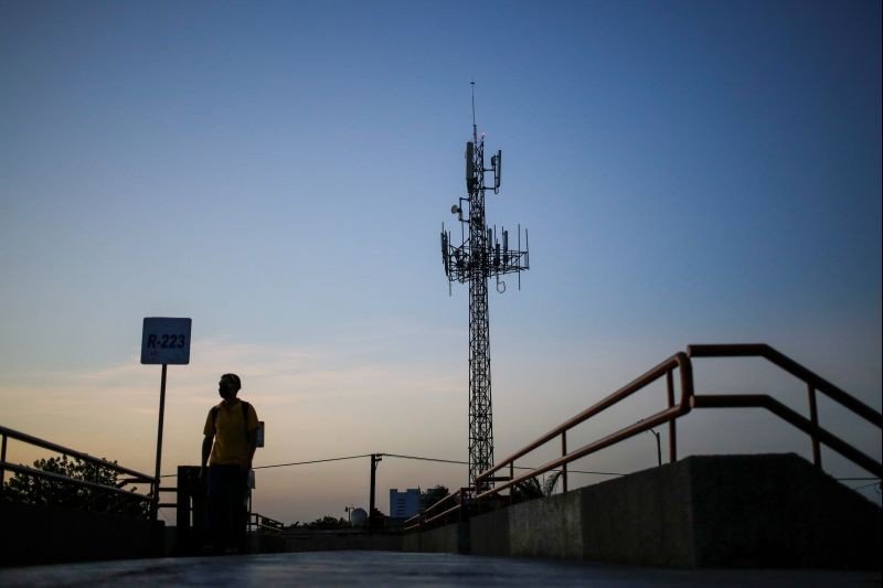 A man walks by near a cellular tower in the municipality of Guadalupe, Mexico on July 6, 2020. (REUTERS File Photo)