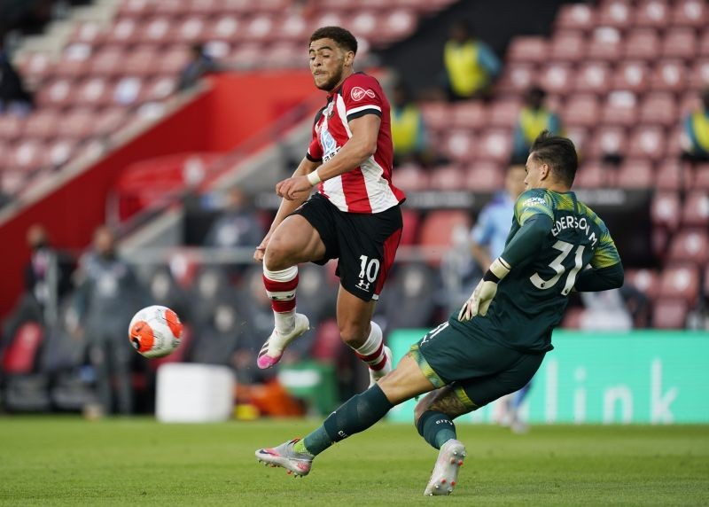 Manchester City's Ederson clears from Southampton's Che Adams, as play resumes behind closed doors following the outbreak of the coronavirus disease (COVID-19) Will Oliver/Pool via REUTERS