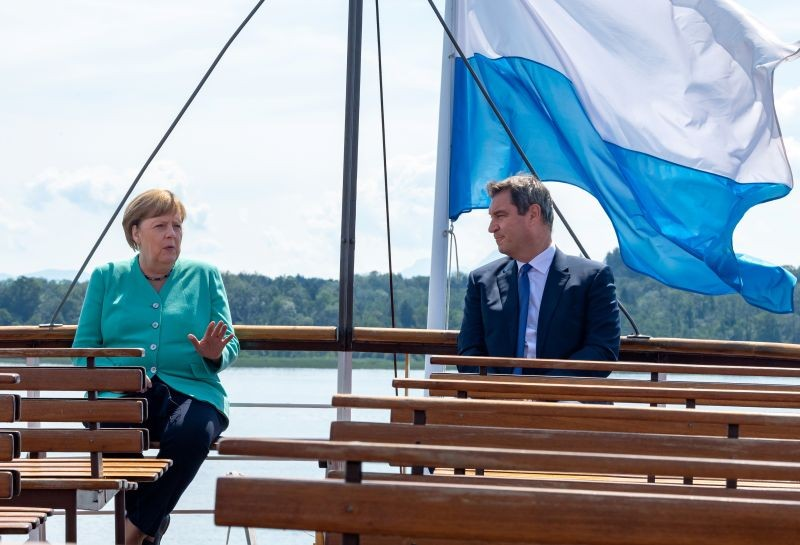 German Chancellor Angela Merkel and Bavarian State Premier Markus Soeder are on their way by boat to attend a Bavarian state cabinet meeting at Herrenchiemsee Island, Germany on July 14.(REUTERS Photo)